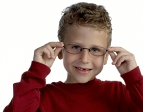 Little boy wearing eyeglasses.